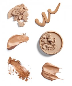 Six makeup samples of powder and liquid foundations on white background