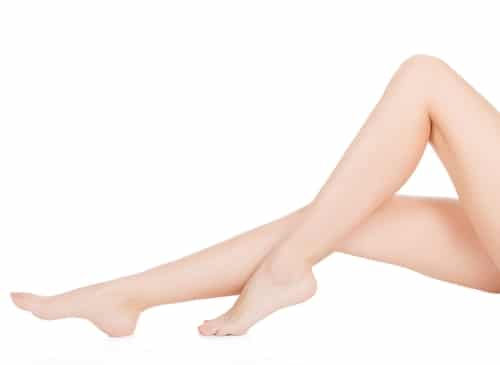 A woman's beautiful legs on a white background